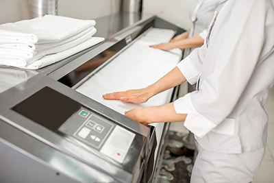 restaurant workers using clean linens in Brooklyn, New York